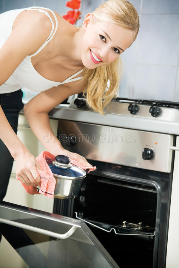 Woman cooking. At domestic kitchen stock photo