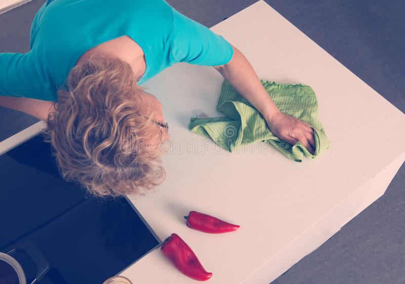 Woman cooking in the kitchen- view from the top royalty free stock photos