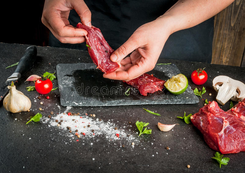 Woman cooking beef meat stock photos