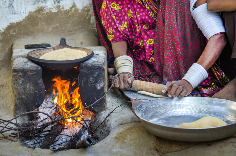 Woman cooking food on wood fire editorial photo image of adult download woman cooking food on wood fire editorial photo image of adult girl forumfinder Choice Image