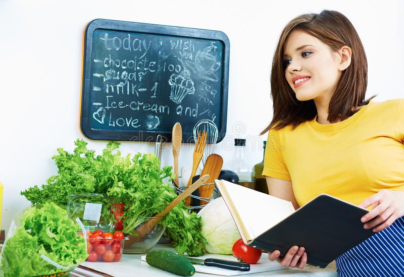 Woman cooking healthy food. In kitchen royalty free stock photography