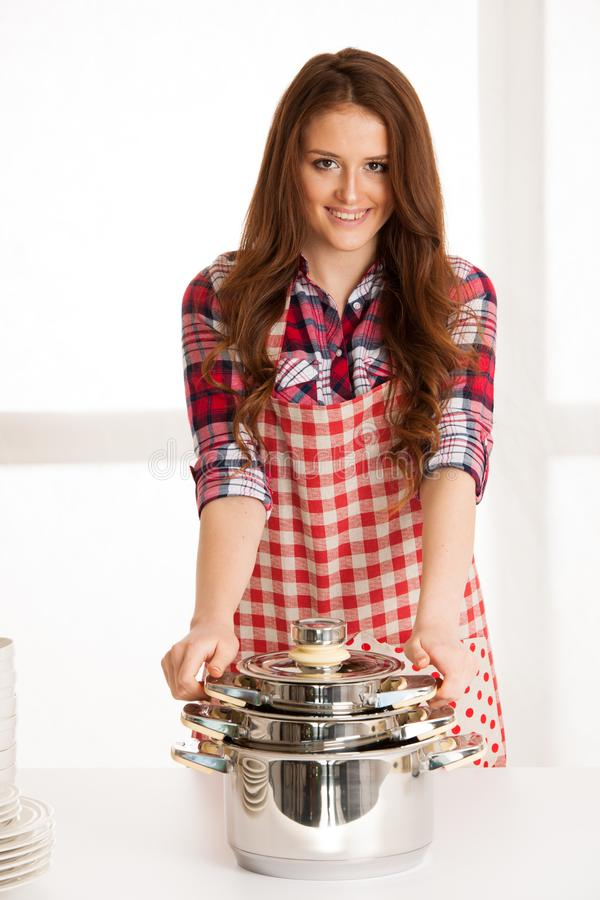 Woman cooking, holding kitchen utensils and pot stock photos