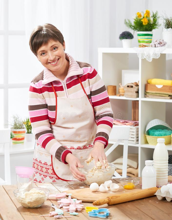 Woman cooking at home kitchen. Healthy food concept royalty free stock photography