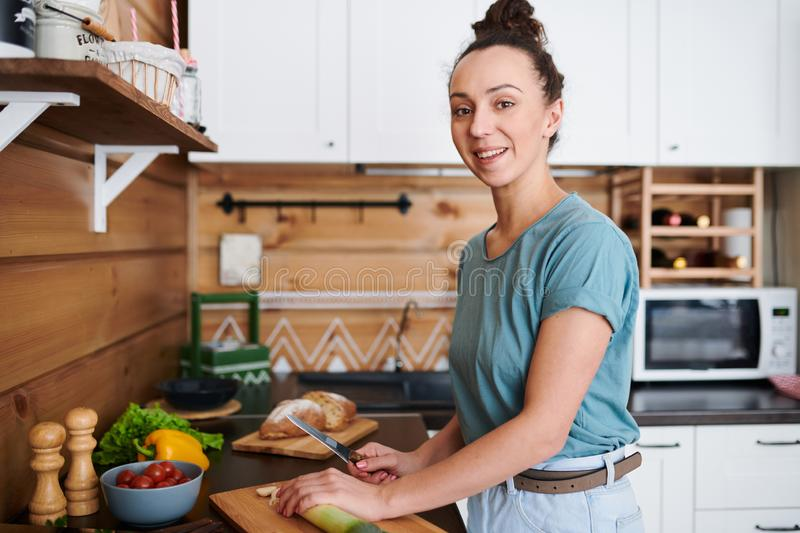 Woman cooking in the kitchen stock images