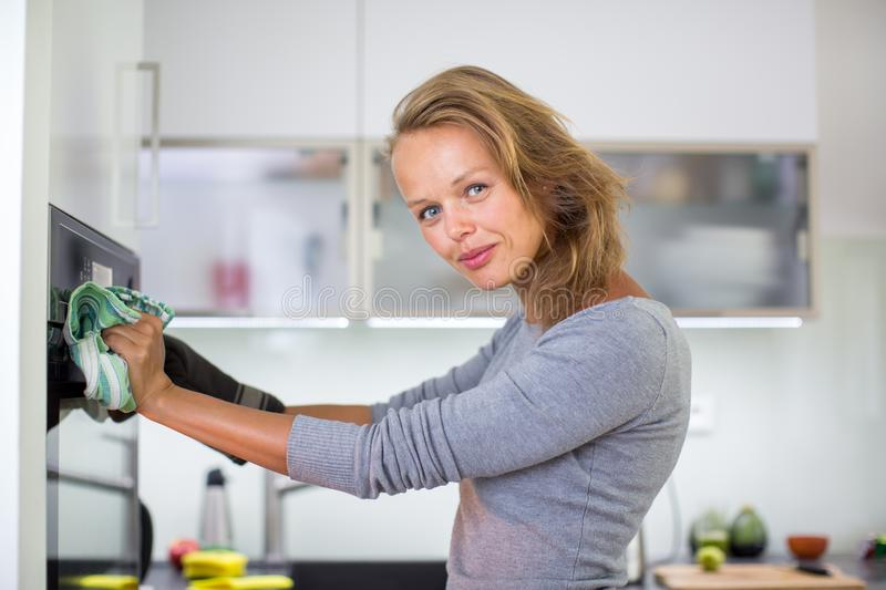 Woman cooking in the kitchen royalty free stock image