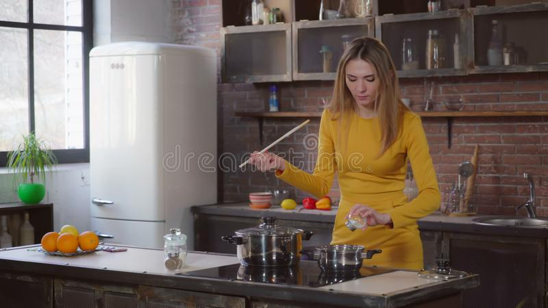 Woman cooking sauce in flat. royalty free stock photos