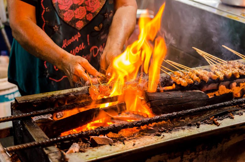 Woman cooking street food in Penang, Malaysia. royalty free stock photos
