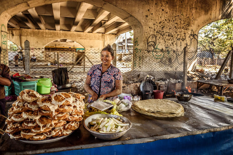 Woman cooking street food in Yangon, Myanmar stock photography