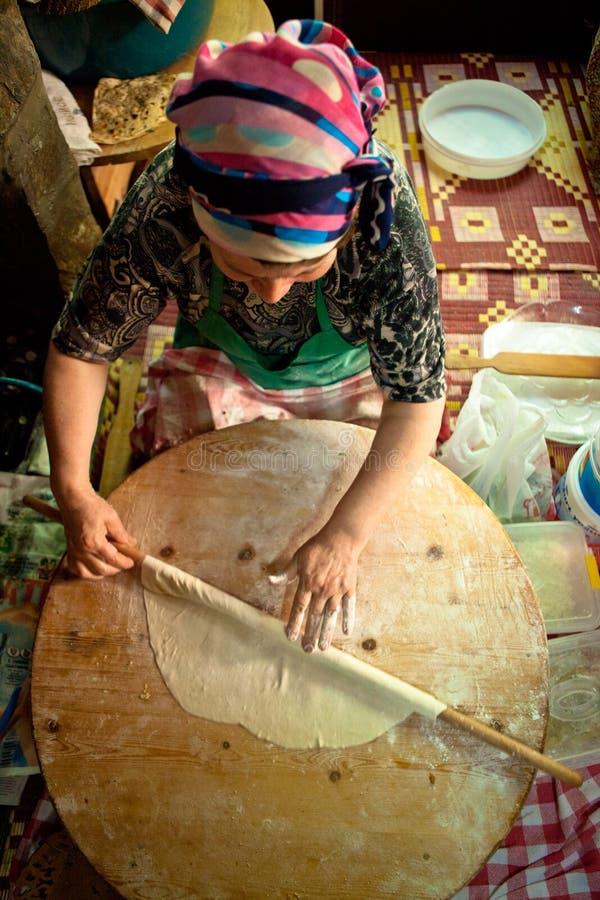 Woman cooking Turkish Pancake. Woman cooks a traditional Turkish pancake on May 24, 2011 in Sirince, Turkey stock photography
