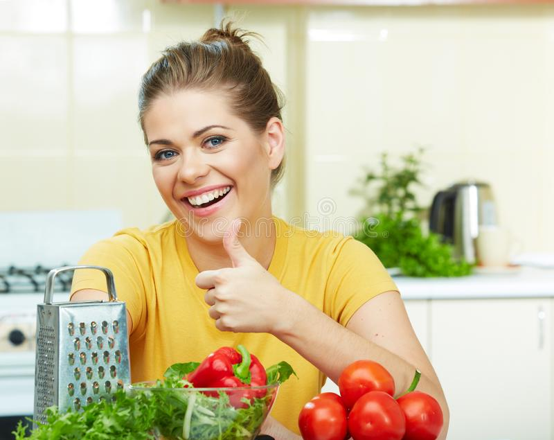 Woman cooking vegetables. In the kitchen stock image