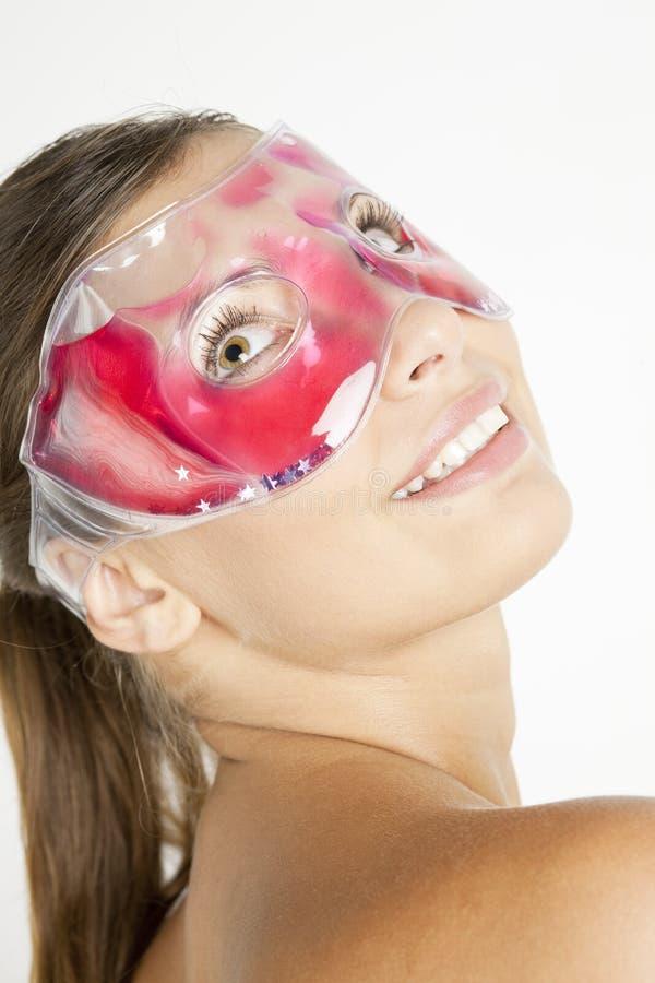 Woman with cooling facial mask stock photos