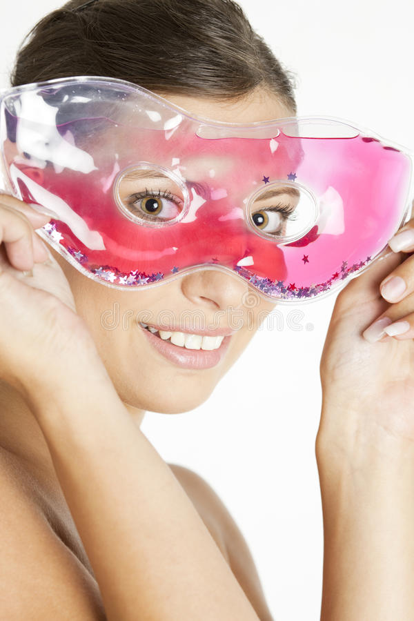 Woman with cooling facial mask royalty free stock images