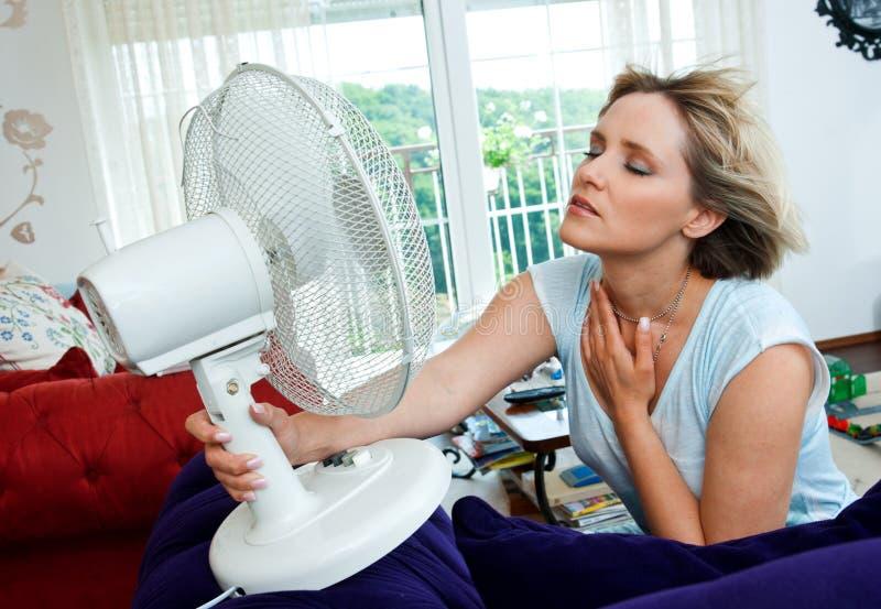 Woman cooling herself stock photos