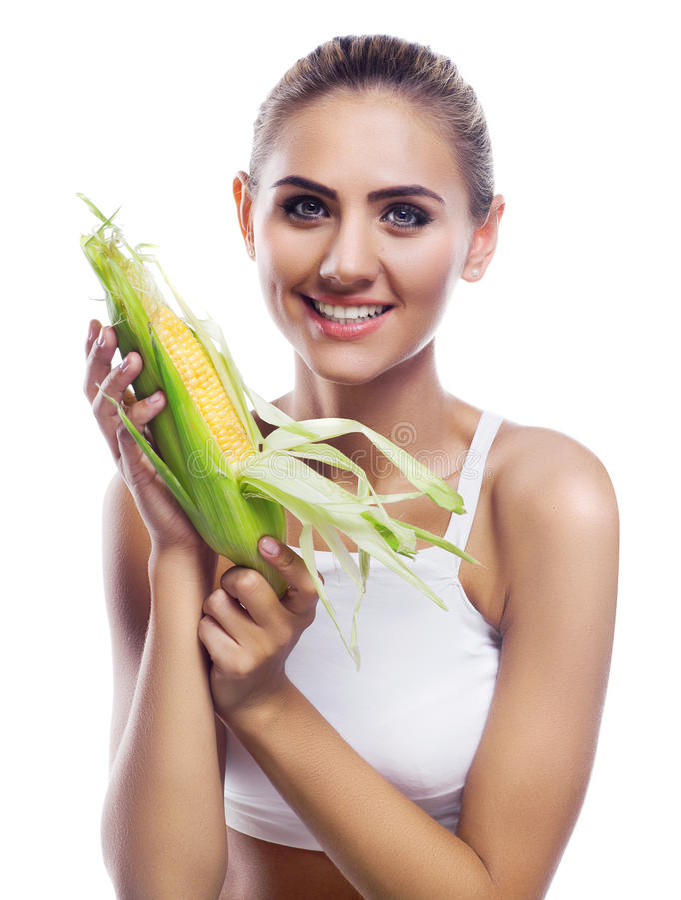 woman with corncob royalty free stock photo