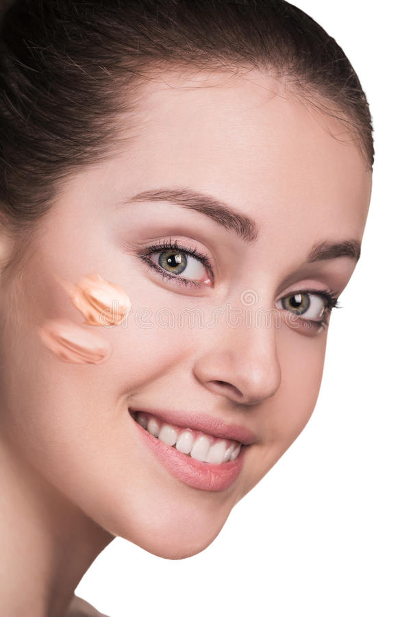 Woman with cosmetic foundation on skin stock photography
