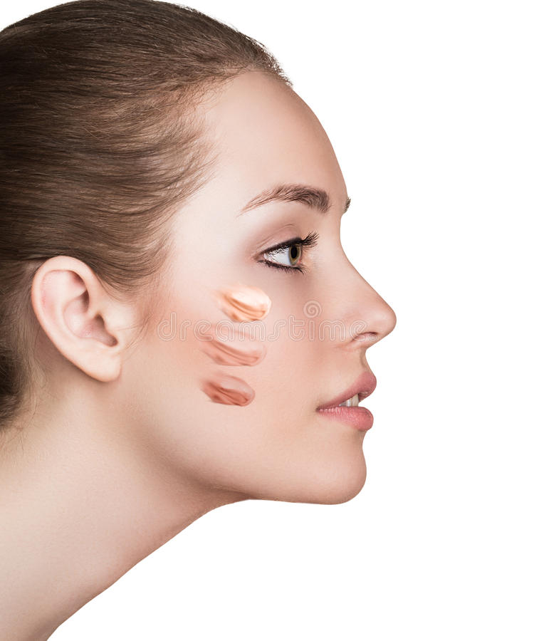 Woman with cosmetic foundation on skin royalty free stock photo