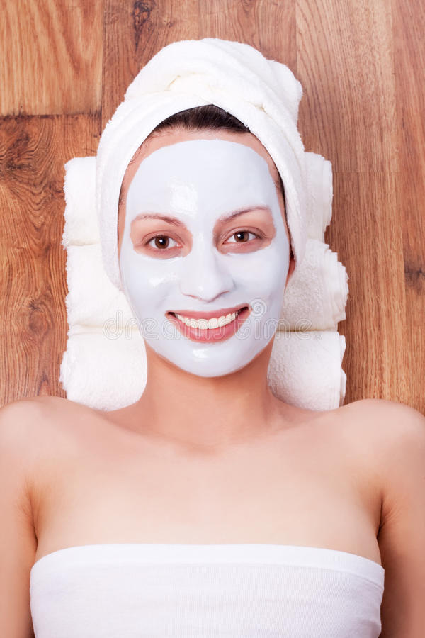 Woman with cosmetic mask on her face royalty free stock photography
