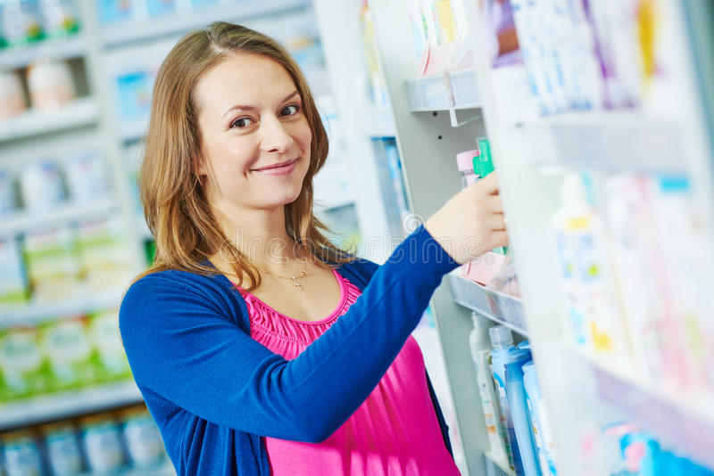 Woman at cosmetic shop stock image