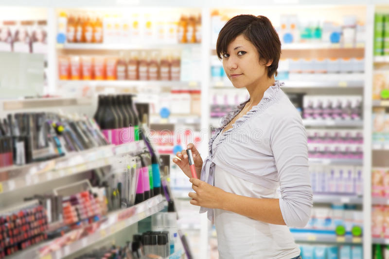 Woman at cosmetics shop royalty free stock photos