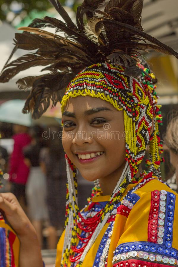 Woman in costume as participant in Davao`s ndak-indak during Kadayawan Festival 2018. Davao, Philippines - August 18, 2018: Woman in costume as participant in royalty free stock photos