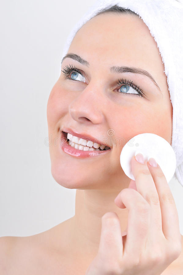 Download Woman With Cotton Swab Cleaning Her Face Stock Photo - Image: 27166644
