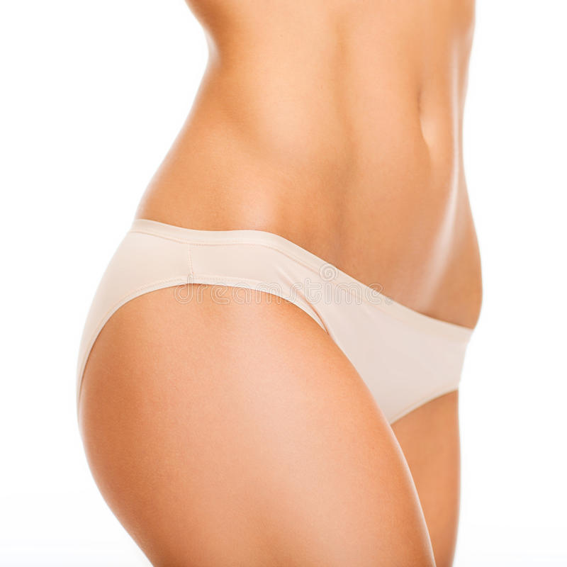 Woman in cotton underwear showing slimming concept stock image