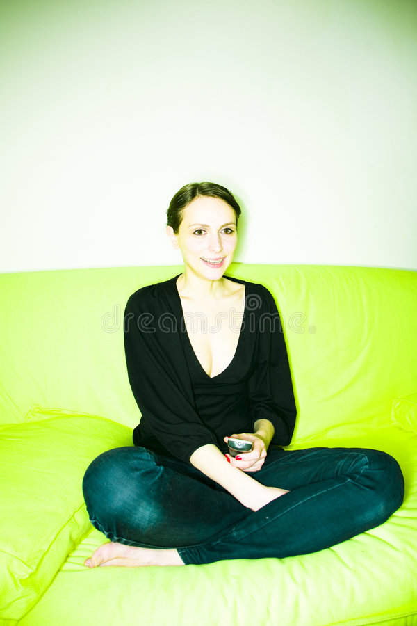 Download Woman on couch stock photo. Image of jeans, holding, casual - 4881012