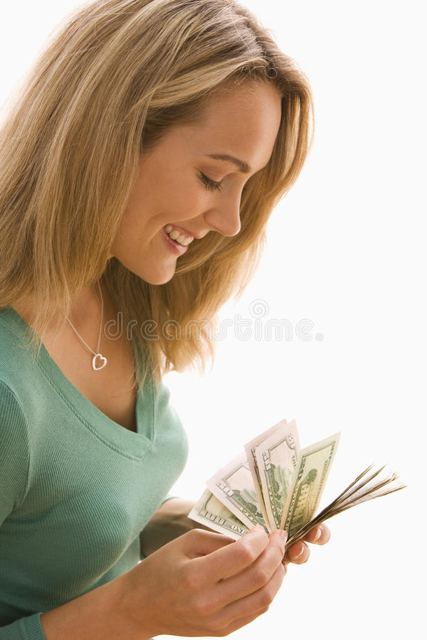 Woman Counting Cash Stock Photography