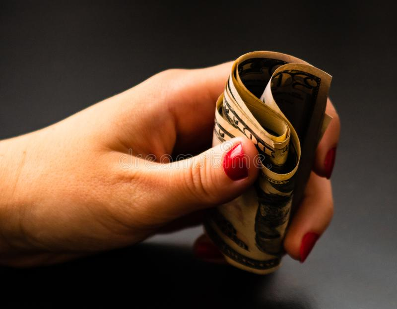 Woman counting money, counting dollars close up.  stock photos