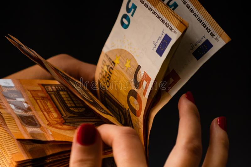 Woman counting money, counting EURO close up.  stock photo