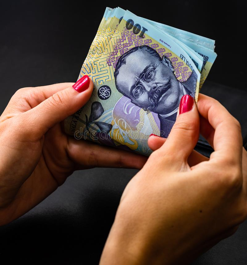 Woman counting money, counting LEI close up.  stock photography