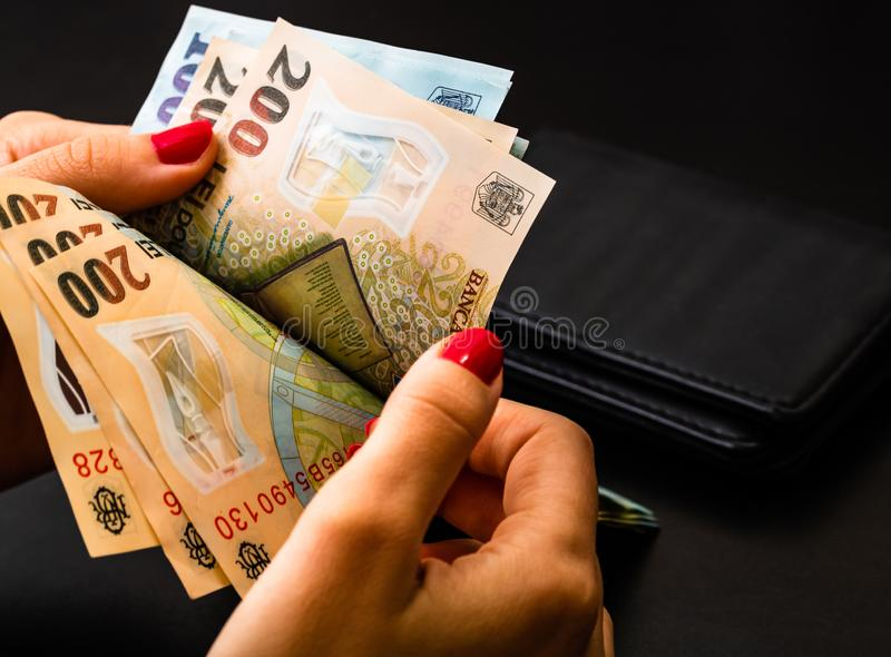 Woman counting money, counting LEI close up.  royalty free stock photography