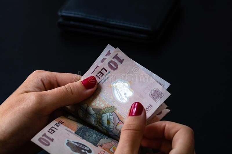 Woman counting money, counting LEI close up.  stock photos