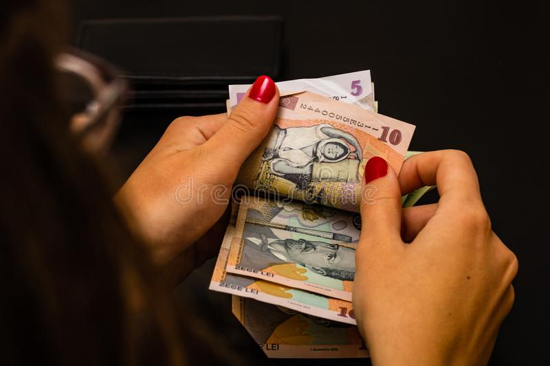 Woman counting money, counting LEI close up.  stock photo