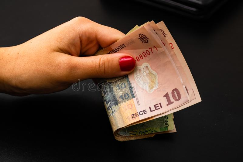 Woman counting money, counting LEI close up.  stock images