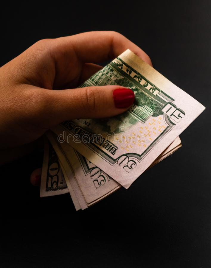 Woman counting money, counting dollars close up.  stock images