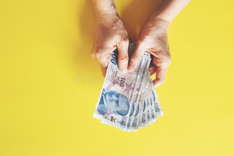 Woman counting money, economy concept, allocation of money. Woman counting money, economy concept and allocation of money, yellow bcakground royalty free stock photos