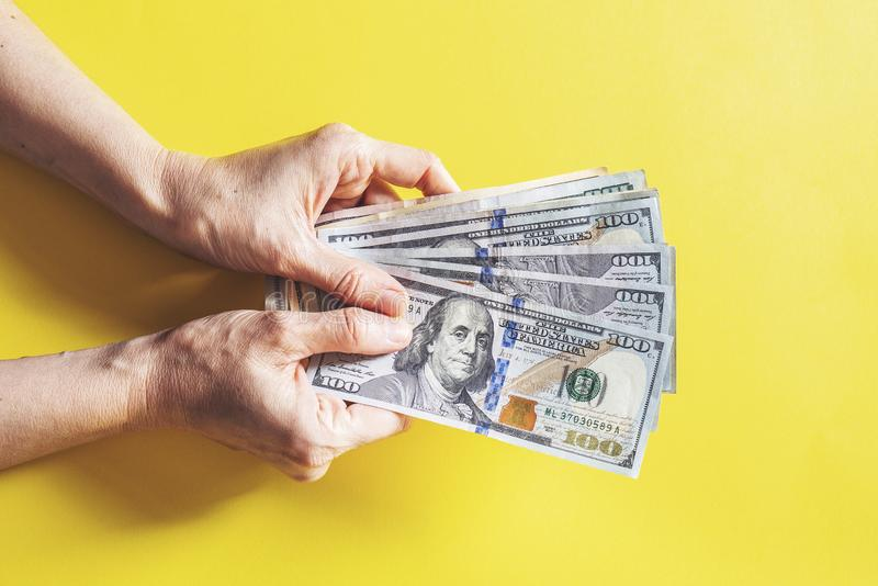 Woman counting money, economy concept, allocation of money. Woman counting money and holding economy concept, allocation of money royalty free stock photography