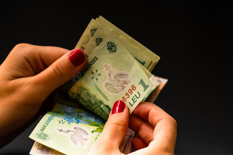 Woman counting money, counting LEI close up.  royalty free stock photo