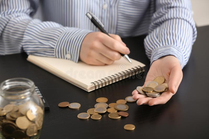 Woman counting money at table. Savings concept royalty free stock photos