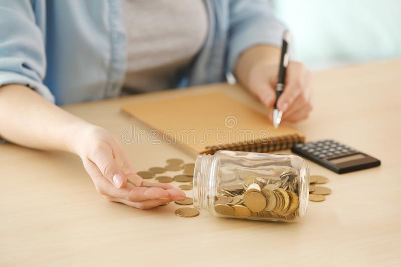 Woman counting money at table. Savings concept royalty free stock photography