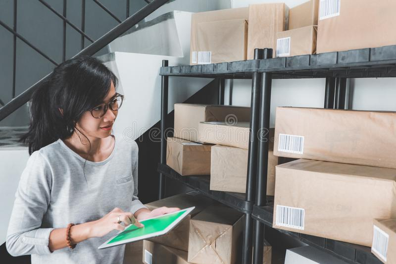Woman counting on package on a shelf royalty free stock photo