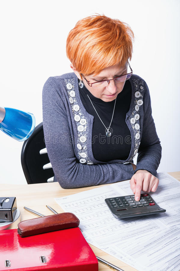 Woman counts taxes stock photo