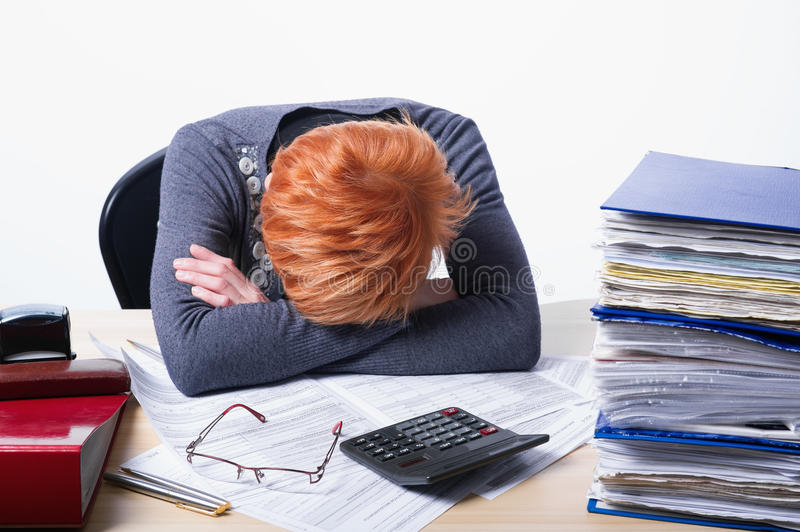 Woman counts taxes stock photos