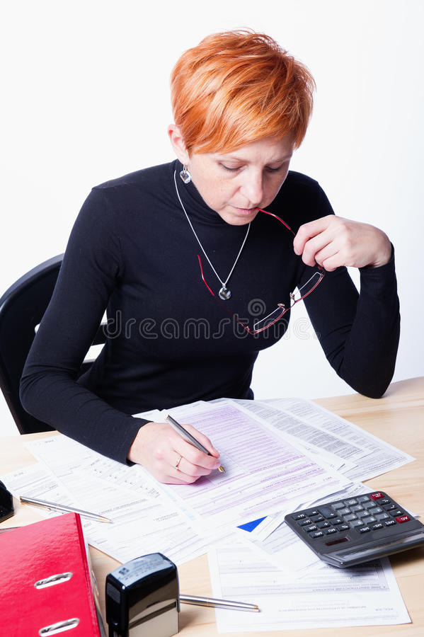 Woman counts taxes royalty free stock image