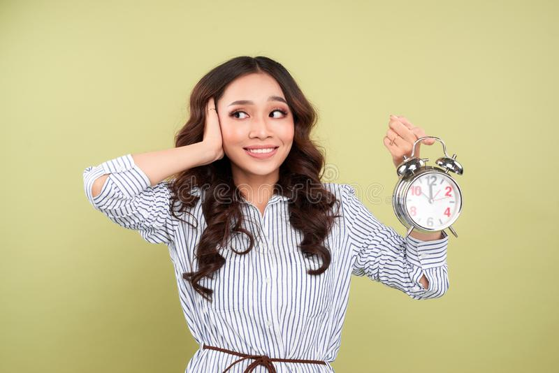 Woman cover her ear from stress out by Alarm clock deadline sound.  royalty free stock images