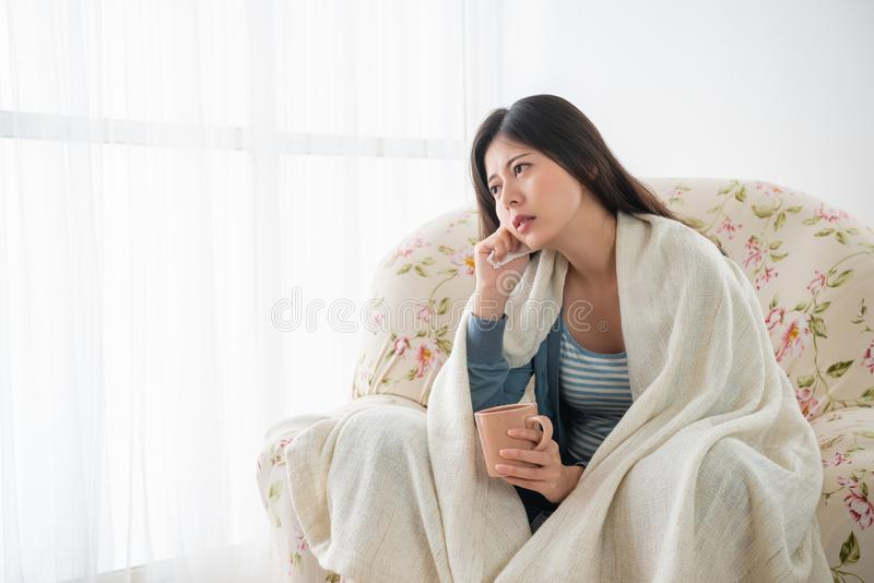 Woman covered with blanket and feeling sick royalty free stock photo