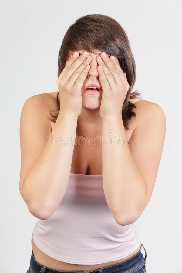 Woman Covering Face In Denial Royalty Free Stock Photo