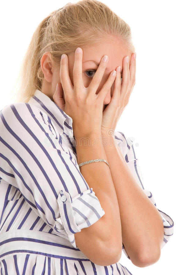 Woman covering face with hands stock photos