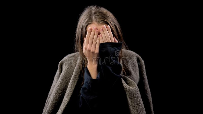 Woman covering face with hands crying in despair, victim of domestic violence. Stock photo royalty free stock photos